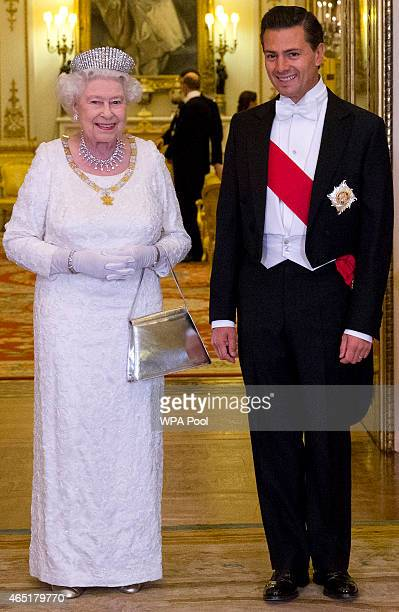 Queen Elizabeth II poses for a photograph with Mexican President Enrique Pena Nieto before a State Banquet at Buckingham Palace on March 3 2015 in...