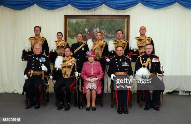 Queen Elizabeth II poses for a photograph with officers from The King's Troop Royal Horse Artillery after the King's Troop Royal Horse Artillery...