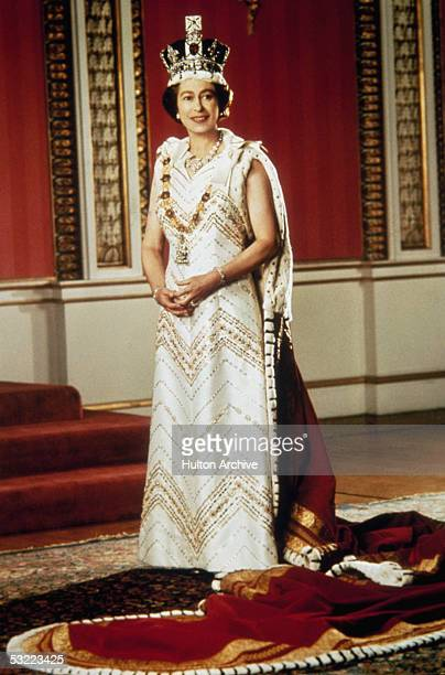 Queen Elizabeth II poses for a silver jubilee portrait in the Throne Room of Buckingham Palace, 6th February 1977.