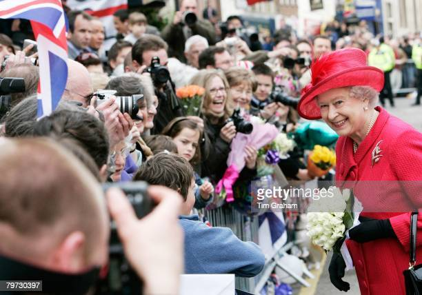 Queen Elizabeth II poses for photographers during a walkabout in Windsor Town Centre where the Queen met the crowds who have gathered to celebrate...