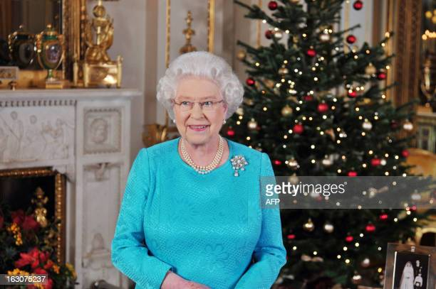 Queen Elizabeth II poses on december 23, 2009 prior recording her Christmas Day broadcast to the Commonwealth, in the White Drawing Room at...