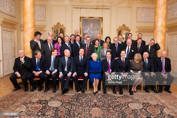 Queen Elizabeth II poses with British Prime Minister David Cameron and cabinet ministers in The Pillared Room at Number 10 Downing Street to attend...