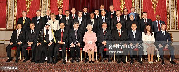Queen Elizabeth II poses with delegates of the G20 London summit for a group photograph in the Throne Room at Buckingham Palace on April 1 2009 in...
