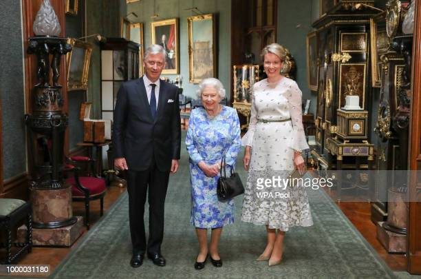 Queen Elizabeth II poses with King Philippe of Belgium and Queen Mathilde of Belgium in the Grand Corridor during their audience at Windsor Castle on...