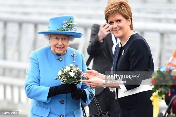 Queen Elizabeth II poses with Scottish First Minister Nicola Sturgeon on the Queensferry Crossing during the official opening ceremony on September 4...