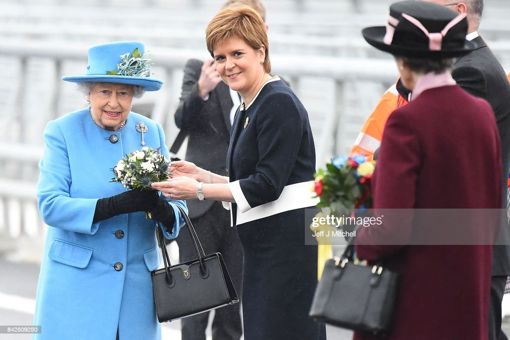 Queen Elizabeth II poses with Scottish First Minister Nicola Sturgeon on the Queensferry Crossing during the official opening ceremony, on September 4, 2017 in South Queensferry, Scotland. Scotland's newest road bridge which began construction in 2011, crosses the Firth of Forth near Edinburgh. The crossing is the world's longest three tower cable stayed bridge.