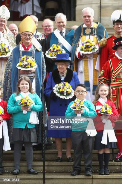 Queen Elizabeth II poses with Yeomen of the Guard after attending the Royal Maundy Service at St George's Chapel on March 29 2018 in Windsor England