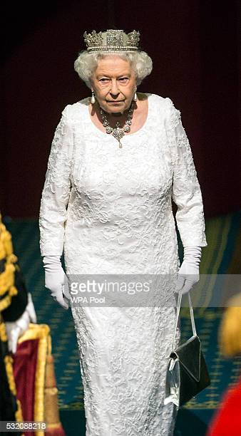 Queen Elizabeth II prepares to leave the Houses of Parliament after the State Opening of Parliament in the House of Lords at the Palace of...