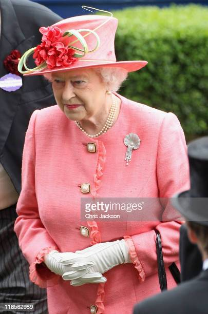 Queen Elizabeth II prepares to present the Gold Cup in the Parade Ring on Ladies Day at Royal Ascot at Ascot Racecourse on June 14 2011 in Ascot...