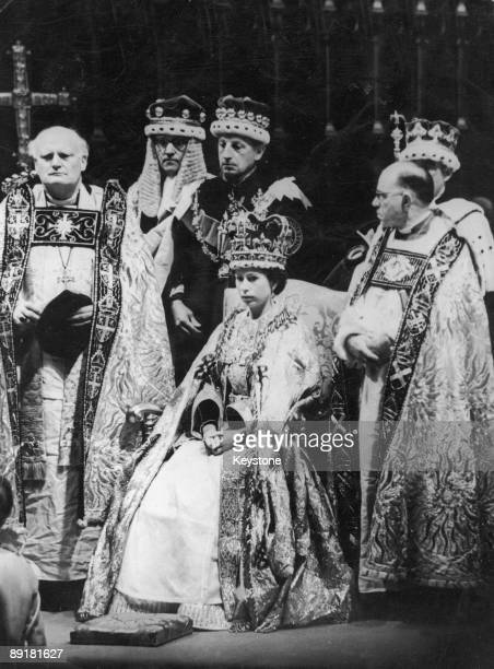 Queen Elizabeth II prepares to receive Homage after her coronation ceremony in Westminster Abbey London 2nd June 1953 Michael Ramsey the Bishop of...
