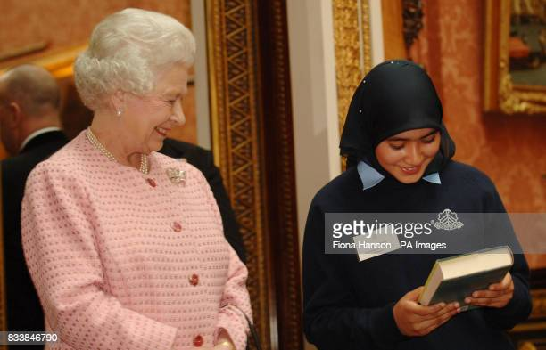 Queen Elizabeth II presents 14 yearold Zainab Ahmed from Sarah Bonnell School Newham with a book selected by the Poet Laureate Andrew Motion From...