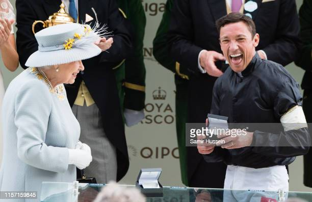 Queen Elizabeth II presents a prize to Frankie Dettori after he won the Gold Cup race on day three, Ladies Day, of Royal Ascot at Ascot Racecourse on...