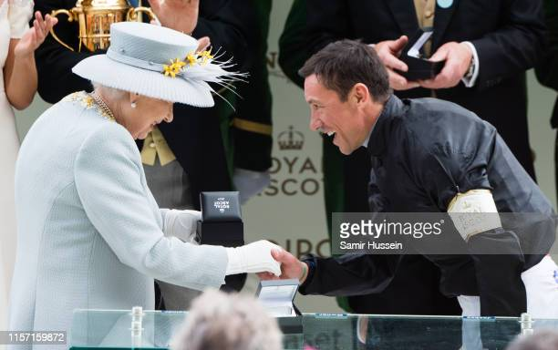 Queen Elizabeth II presents a prize to Frankie Dettori after he won the Gold Cup race on day three Ladies Day of Royal Ascot at Ascot Racecourse on...