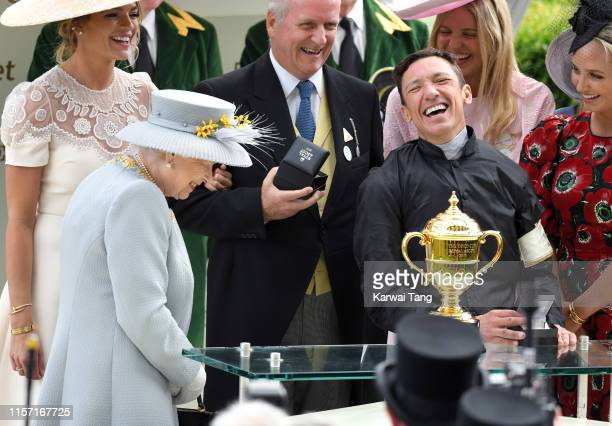 Queen Elizabeth II presents a prize to Frankie Dettori after he won the Gold Cup race riding Stradivarius on day three day three Ladies Day of Royal...