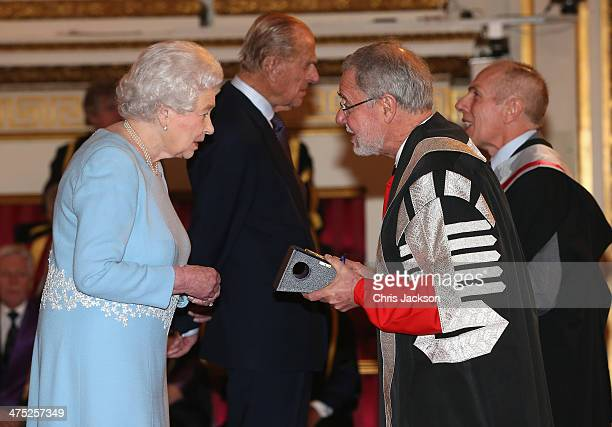Queen Elizabeth II presents a Queen's Anniversary Prize for Higher and Further Education Award to representatives from the University of Newcastle on...