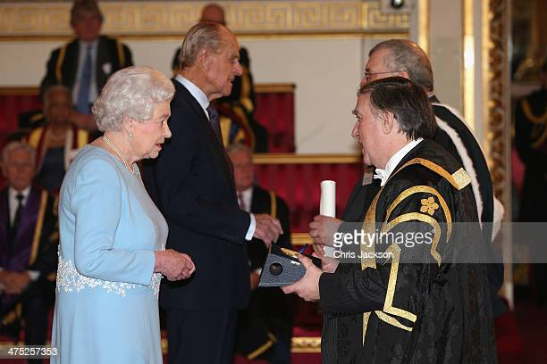 Queen Elizabeth II presents a Queen's Anniversary Prize for Higher and Further Education Award to Sir Robert Burgess of the University of Leicester...