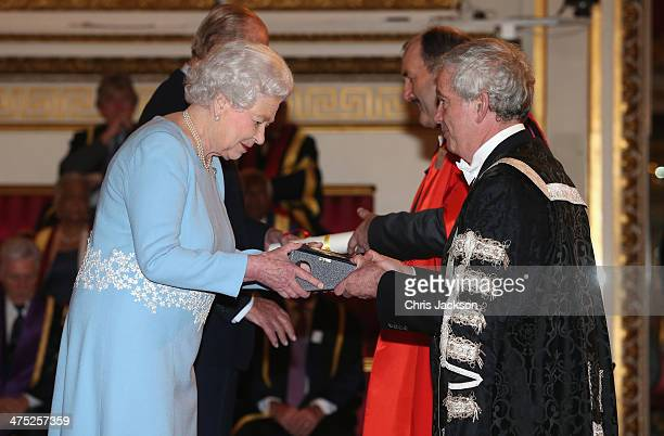 Queen Elizabeth II presents a Queen's Anniversary Prize for Higher and Further Education Award representatives from the University of Edinburgh on...