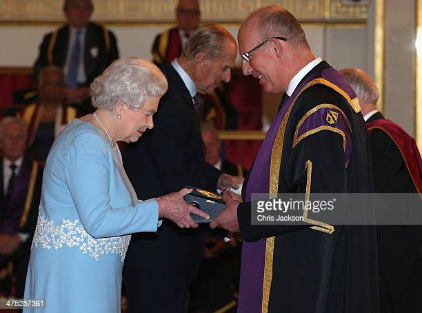 Queen Elizabeth II presents a Queen's Anniversary Prize for Higher and Further Education Award to representatives from the University of Loughborough...