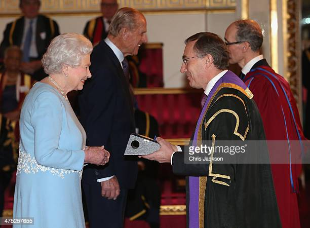 Queen Elizabeth II presents a Queen's Anniversary Prize for Higher and Further Education Award to Michael Arthur of University College London on...