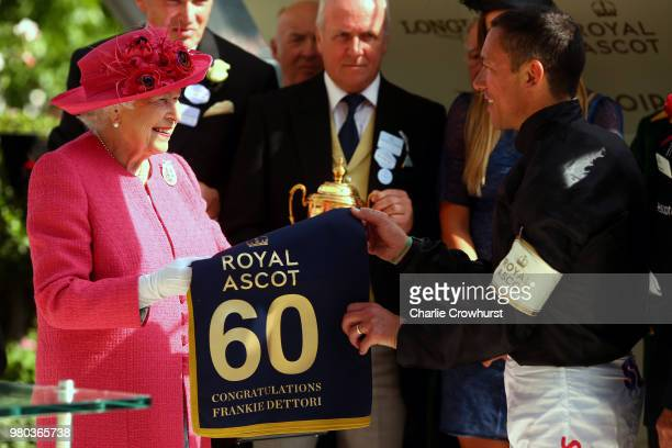 Queen Elizabeth II presents Frankie Dettori with his award for winning The Gold Cup on day 3 of Royal Ascot at Ascot Racecourse on June 21 2018 in...