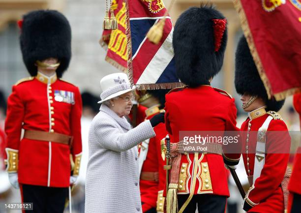 Queen Elizabeth II presents new colours to the 1st Battalion and No. 7 Company the Coldstream Guards at Windsor Castle, on May 3, 2012 in Windsor,...