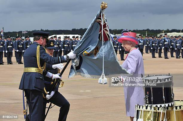 Queen Elizabeth II presents new colours to the RAF at RAF Fairford where she then watched a fly-past to celebrate the 90th birthday of the Royal Air...