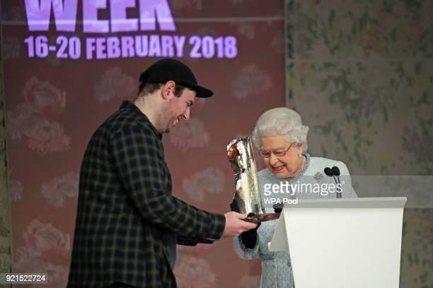 Queen Elizabeth II presents Richard Quinn with the inaugural Queen Elizabeth II Award for British Design, as she visits London Fashion Week's BFC...