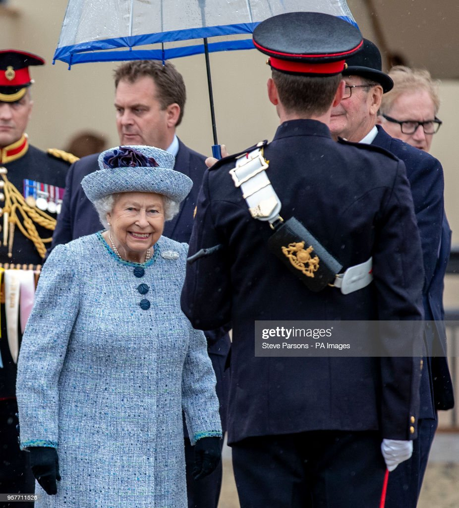 Queen Elizabeth II presents the awards to the Best turned out trooper of the Household Cavalry during day four of the Royal Windsor Horse Show at Windsor Castle, Berkshire.