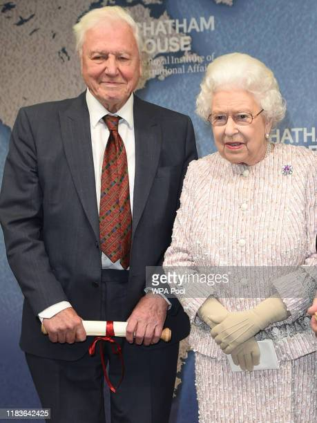 Queen Elizabeth II presents the Chatham House Prize 2019 to Sir David Attenborough and Julian Hector, Head of the BBC Natural History Unit at the...