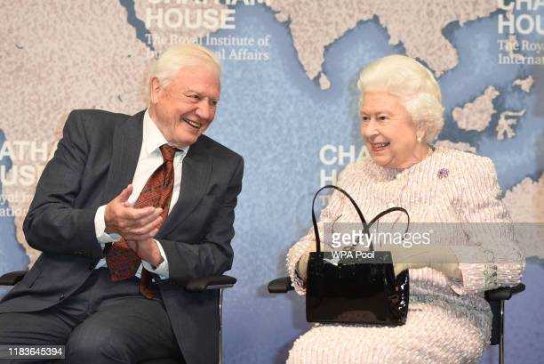 Queen Elizabeth II presents the Chatham House Prize 2019 to Sir David Attenborough at the Royal institute of International Affairs Chatham House on...