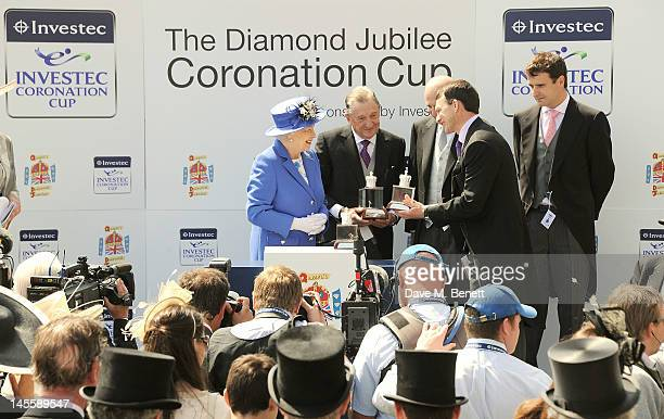 Queen Elizabeth II presents The Diamond Jubilee Coronation Cup sponsored by Investec to Jockey Joseph O'Brien, trainer Aiden O'Brien and owners...