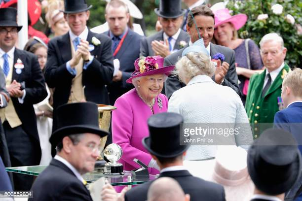 Queen Elizabeth II presents the Diamond Jubilee Stakes Cup after The Tin Man wins ridden by Tom Queally on day 5 of Royal Ascot 2017 at Ascot...