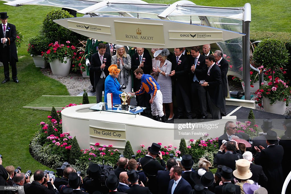 Queen Elizabeth II Presents the Gold Cup Jockey prize to jockey Ryan Moore on day 3 of Royal Ascot at Ascot Racecourse on June 16, 2016 in Ascot, England.