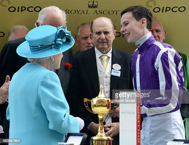 Queen Elizabeth II presents The Gold Cup to jockey Joseph O'Brien during day three of Royal Ascot at Ascot Racecourse on June 19 2014 in Ascot England