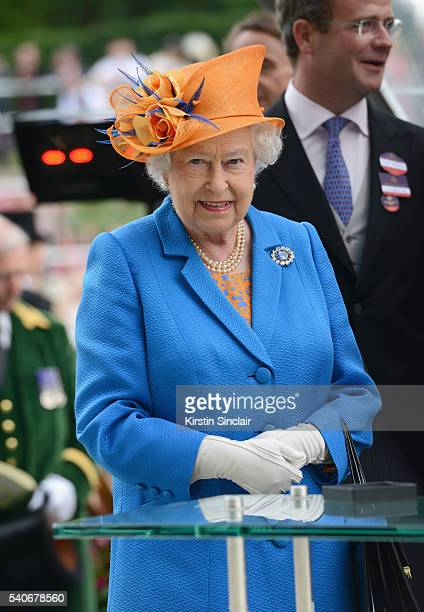 Queen Elizabeth II presents The Gold Cup Trophy in Honour of The Queen's 90th Birthday to winning horse Order of St George on day 3 of Royal Ascot at...