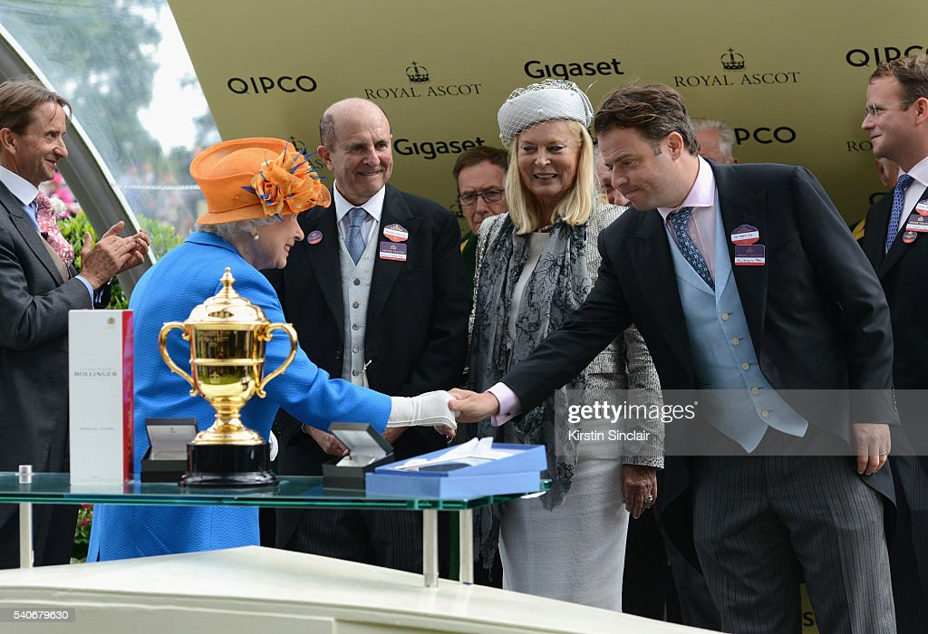 Queen Elizabeth II presents The Gold Cup Trophy, in Honour of The Queen's 90th Birthday, for winning horse Order of St George, to Owner Tom Magnier on day 3 of Royal Ascot at Ascot Racecourse on June 16, 2016 in Ascot, England.