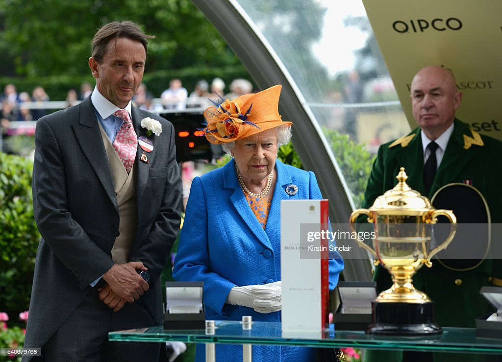 Queen Elizabeth II presents The Gold Cup Trophy, in Honour of The Queen's 90th Birthday, to winning horse Order of St George on day 3 of Royal Ascot at Ascot Racecourse on June 16, 2016 in Ascot, England.