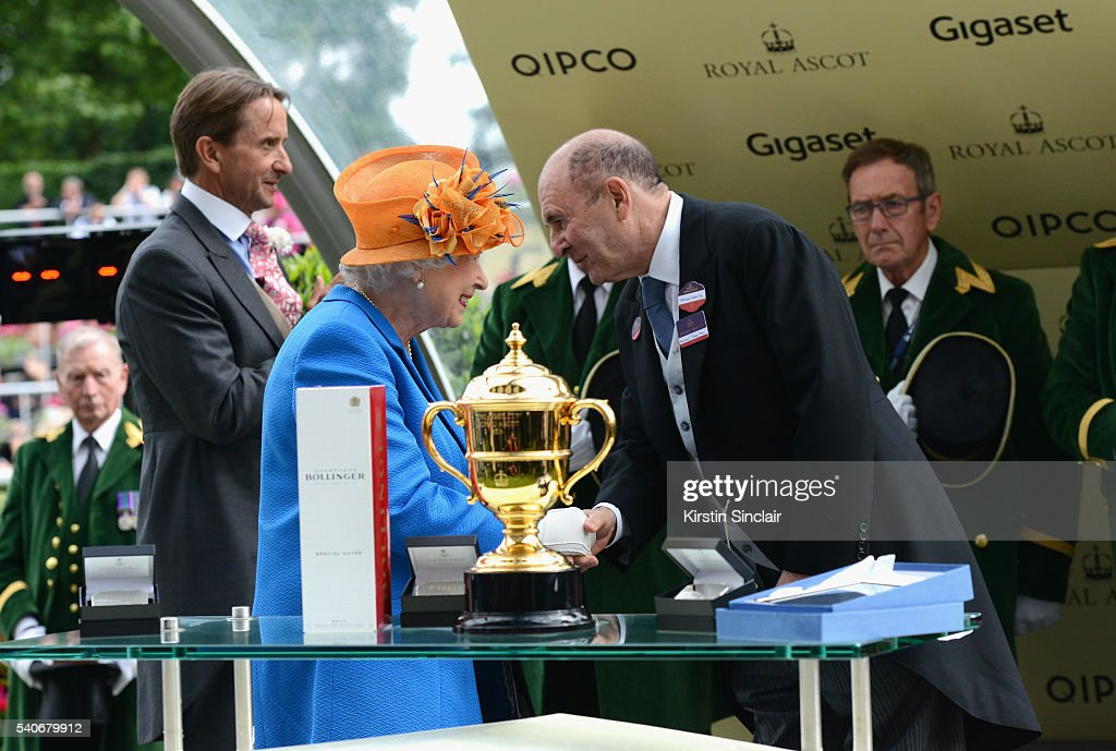 Queen Elizabeth II presents The Gold Cup Trophy, in Honour of The Queen's 90th Birthday, for winning horse Order of St George, to Owner Michael Tabor on day 3 of Royal Ascot at Ascot Racecourse on June 16, 2016 in Ascot, England.