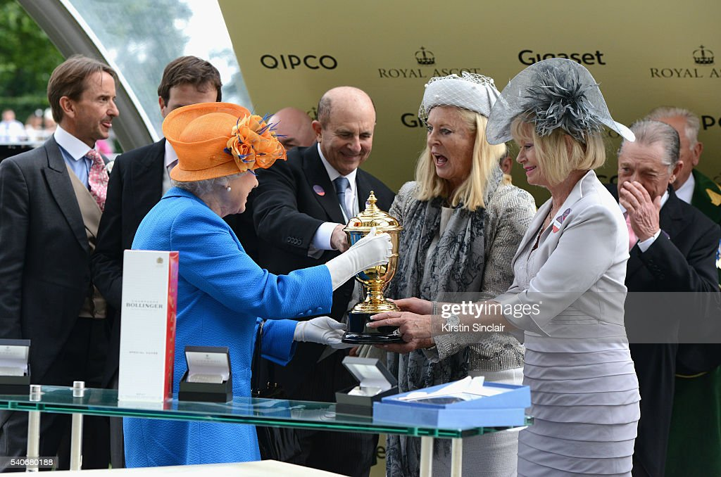 Queen Elizabeth II presents The Gold Cup Trophy, in Honour of The Queen's 90th Birthday, for winning horse Order of St George on day 3 of Royal Ascot at Ascot Racecourse on June 16, 2016 in Ascot, England.