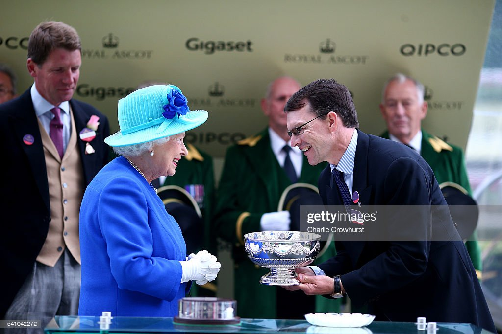 Queen Elizabeth II presents the Leading Trainers Trophy to Aidan O'Brien on day 5 of Royal Ascot at Ascot Racecourse on June 18, 2016 in Ascot, England.