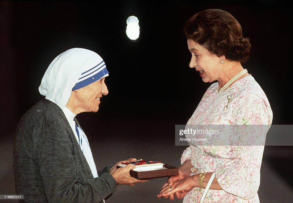 HM Queen Elizabeth II (R) presents the Order of Merit to Mother Teresa of Calcutta in India, 1982