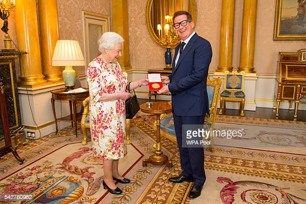 Queen Elizabeth II presents the Queen Elizabeth II Coronation Award to choreographer Sir Matthew Bourne at Buckingham Palace on June 24 2016 in...