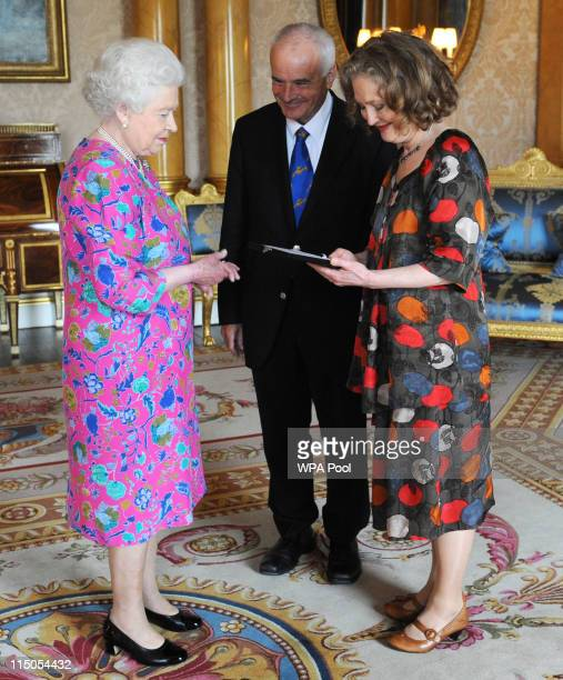 Queen Elizabeth II presents The Queen's Medal For Music to Dame Emma Kirkby watched by the Master of The Queen's Music Sir Peter Maxwell Davies at...