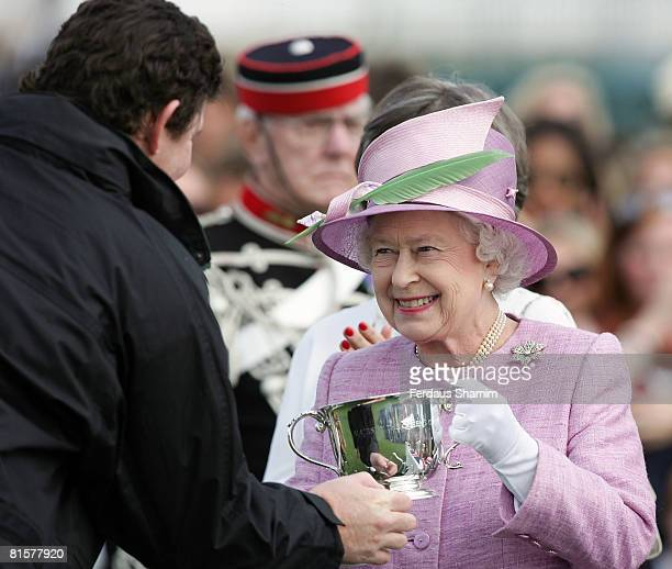 Queen Elizabeth II presents the trophies to the winners of the Vivari Queens Cup Final at Guards Polo Club on June 15, 2008 in Windsor, England.