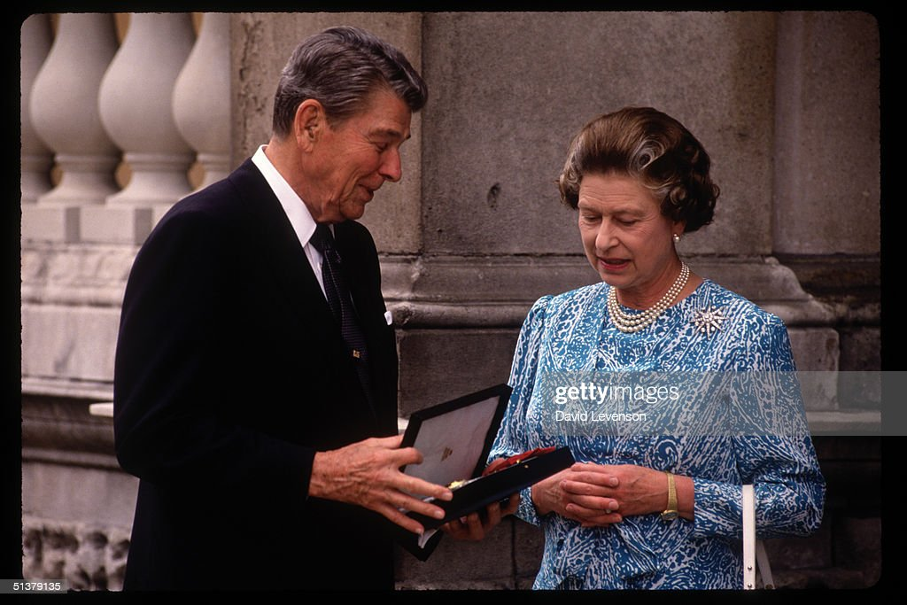 Queen Elizabeth II presents US President Ronald Reagan with an honoury Knighthood : News Photo