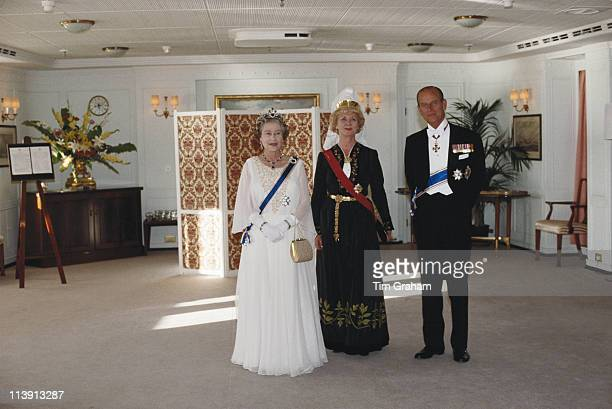 Queen Elizabeth II President of Iceland Vigdis Finnbogadottir and Prince Philip on board the royal yacht Britannia during a threeday State Visit to...