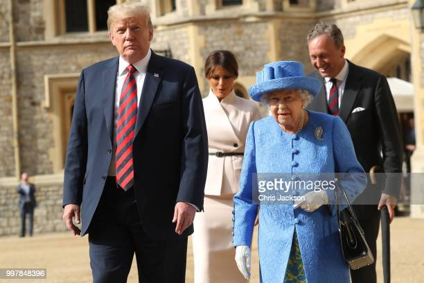 Queen Elizabeth II President of the United States Donald Trump and First Lady Melania Trump walk from the Quadrangle after inspecting an honour guard...