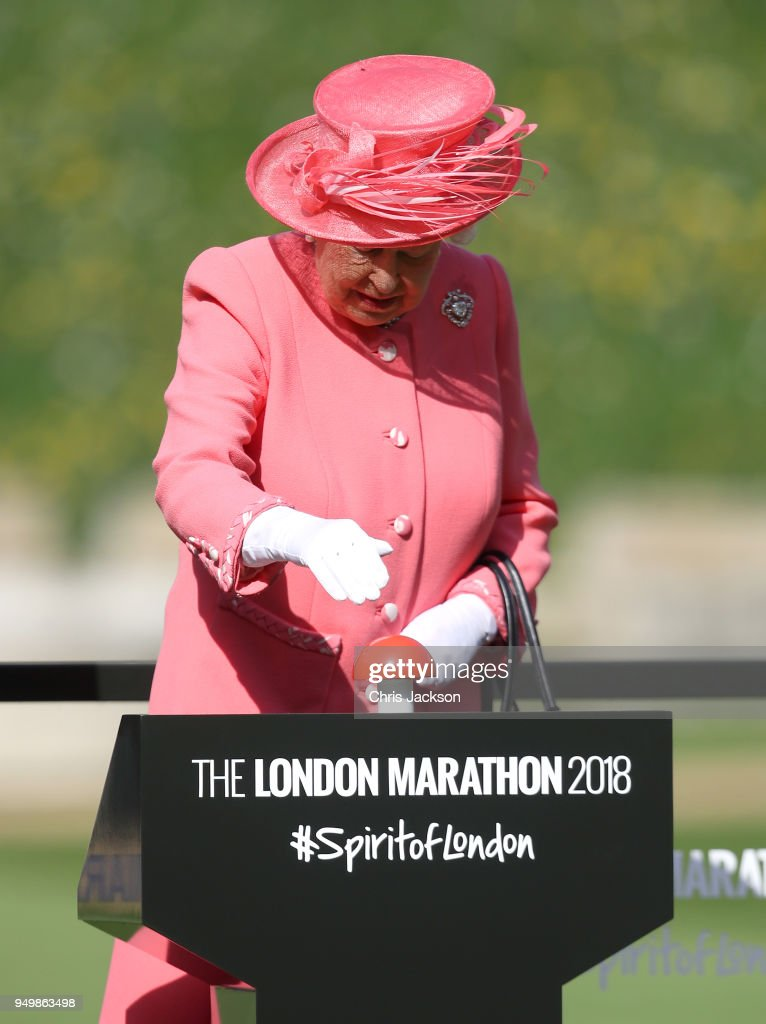 Queen Elizabeth II presses a button to start the London Marathon from Windsor Castle, which is relayed to big screens at Blackheath, setting off 40,000 runners on the 26.2 miles to The Mall, on April 22, 2018 in Windsor, England.