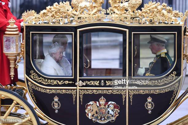 Queen Elizabeth II Prince Charles Prince of Wales and Camilla Duchess of Cornwall are transported in a carriage along The Mall ahead of the State...