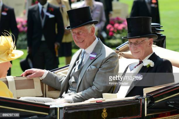 Queen Elizabeth II Prince Charles Prince of Wales and Lord Fellowes enter the parade ring during the Royal Processionon day 2 of Royal Ascot at Ascot...